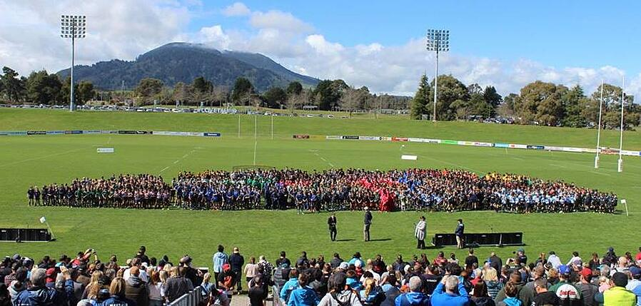 Junior rugby teams gathered on New Zealand rugby field for photos