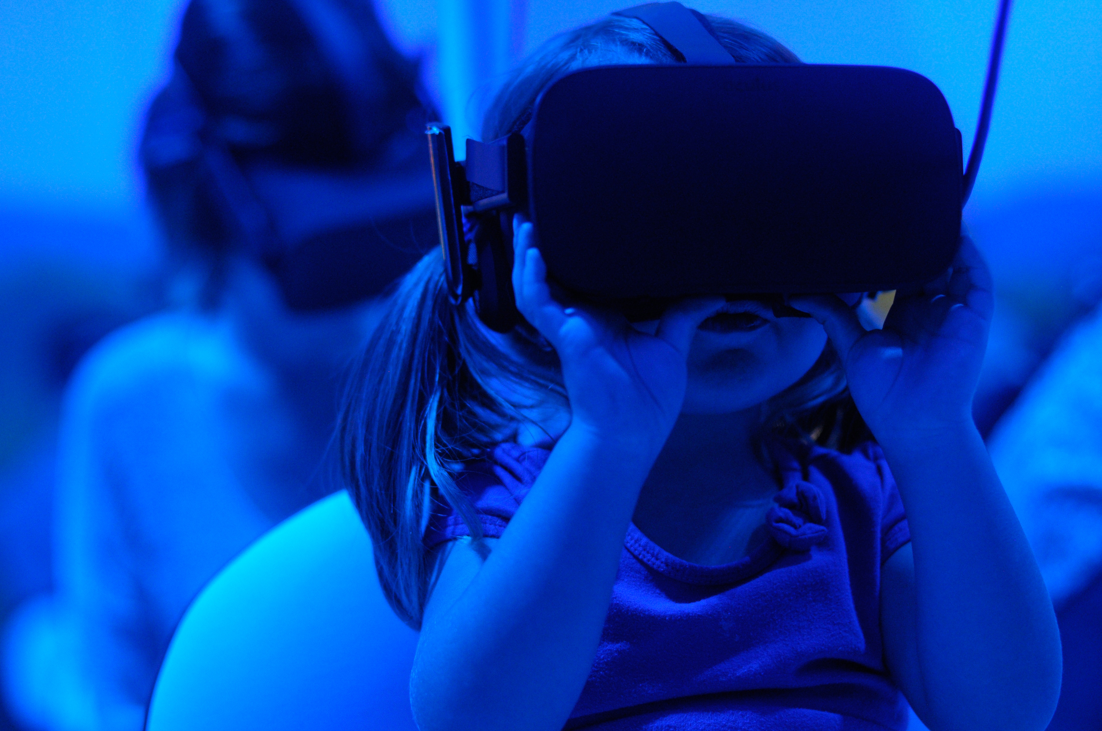 Young girl using tech which is an augmented reality device
