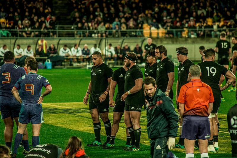 close up of all blacks rugby team before a scrum