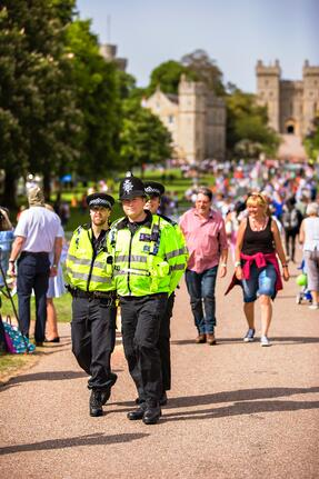 three policemen at an event walking through the crowd
